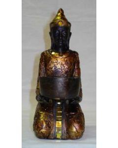 Buddha i guldlook til fyrfadslys